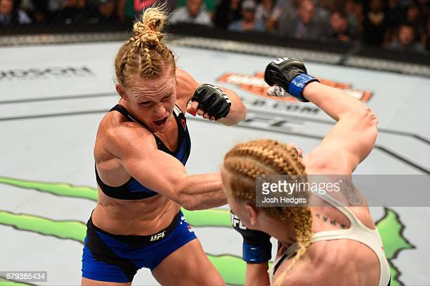Holly Holm punches Valentina Shevchenko of Kyrgyzstan in their women's bantamweight bout during the UFC Fight Night event at the United Center on...
