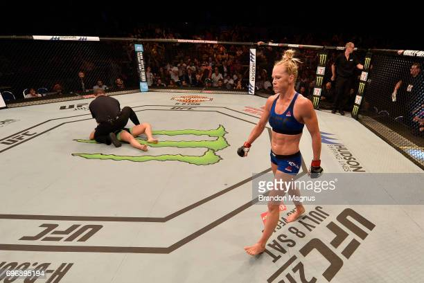 Holly Holm reacts after her knockout victory over Bethe Correia of Brazil in their women's bantamweight bout during the UFC Fight Night event at the...