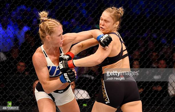 Holly Holm throws a lefthanded punch against Ronda Rousey in the first round of their UFC women's bantamweight championship bout during the UFC 193...