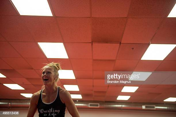 Holly Holm trains with her wrestling partner at Jackson's Mixed Martial Arts & Fitness on October 30, 2015 in Albuquerque, New Mexico.
