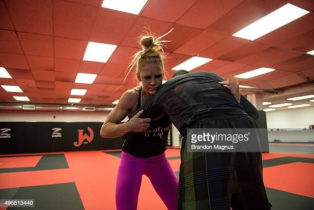 Holly Holm trains with her wrestling partner at Jackson's Mixed Martial Arts Fitness on October 30 2015 in Albuquerque New Mexico