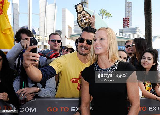 Holly Holm visits 'Extra' at Universal Studios Hollywood on November 19 2015 in Universal City California