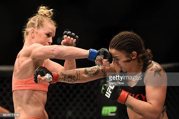 Holly Holms and Raquel Pennington exchange punches in their women's bantamweight bout during the UFC 184 event at Staples Center on February 28 2015...