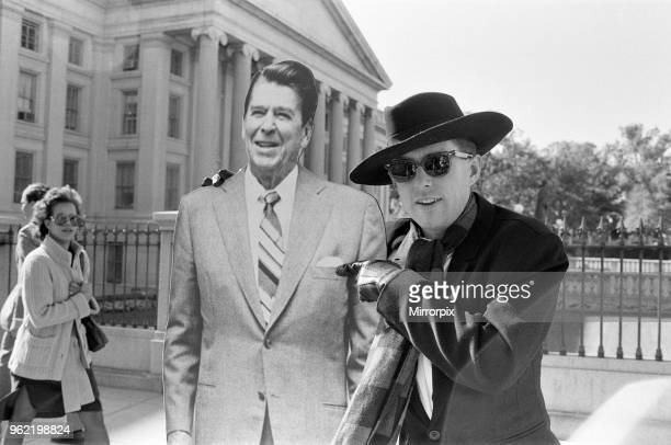 Holly Johnson posing outside the White House with a fullsize cutout of Ronald Reagan Liverpool band Frankie Goes To Hollywood at Capitol Hill in...