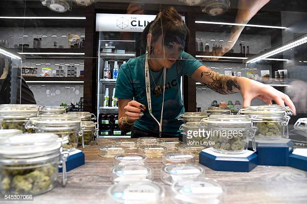 Holly Kinnel straightens out the display case at the new location for The Clinic one of the larger marijuana retailers in Denver has a new location...