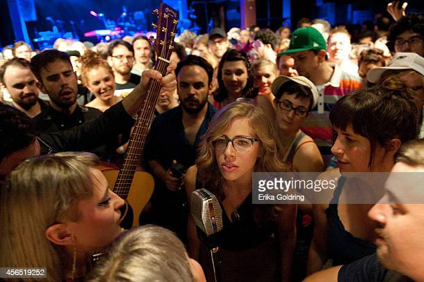 Holly Laessig and Jess Wolfe of Lucius along with Rachel Price and Bridget Kearney of Lake Street Dive perform in the crowd at Tipitina's on October...