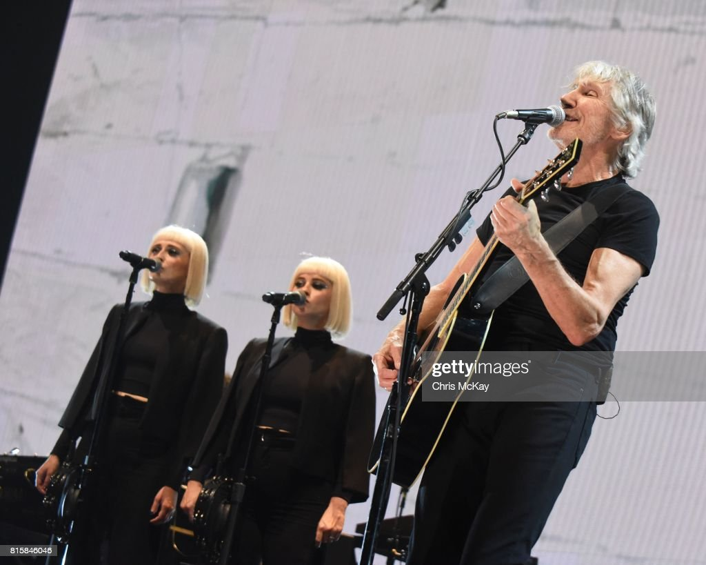 Holly Laessig and Jess Wolfe of Lucius perform with Pink Floyd founding member Roger Waters during the Us + Them Tour at Infinite Energy Center on July 16, 2017 in Duluth, Georgia.