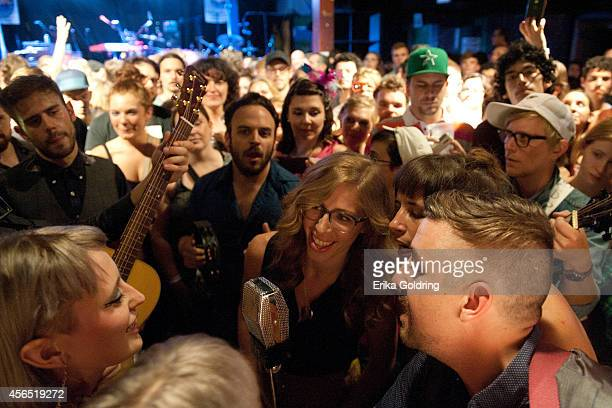 Holly Laessig and Jess Wolfe of Lucius Rachel Price and Bridget Kearney of Lake Street Dive and members of their bands perform in the crowd at...