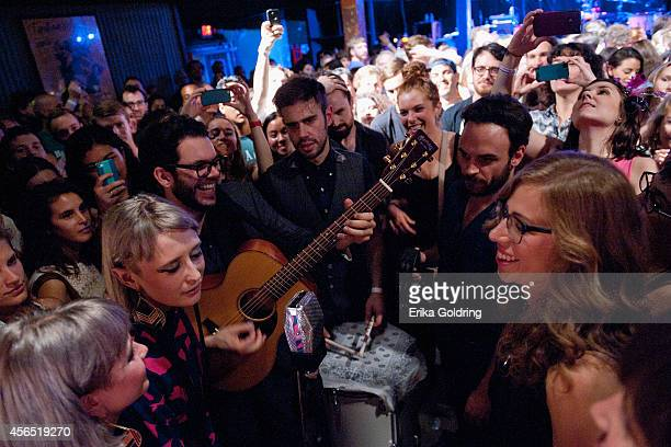 Holly Laessig and Jess Wolfe of Lucius Rachel Price of Lake Street Dive and members of their bands perform in the crowd at Tipitina's on October 1...