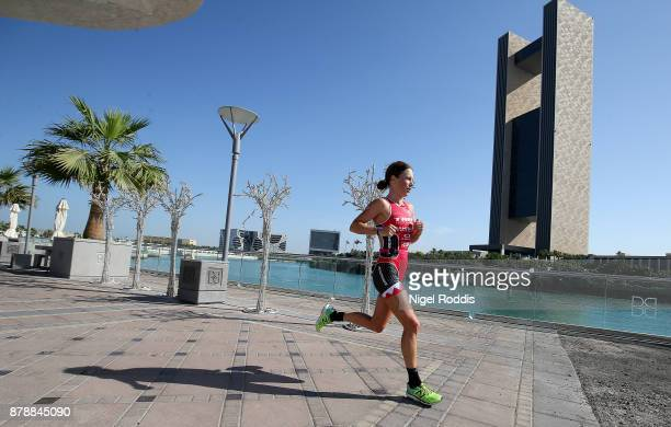 Holly Lawrence of Britain competes in the run section of Ironman 703 Middle East Championship Bahrain on November 25 2017 in Bahrain Bahrain