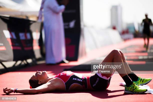 Holly Lawrence of Great Britain celebrates as she wins the women's race of IRONMAN 703 Middle East Championship Bahrain on November 25 2017 in...