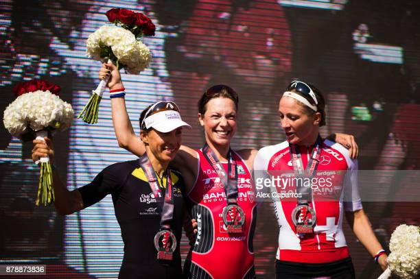 Holly Lawrence of Great Britain in 1st place Anne Haug of Germany in 2nd place and Daniela Ryf of Switzerland in 3rd place celebrate their positions...