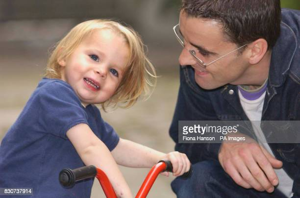 Holly Loach age 2 from Peckham London who is deaf and has received a pioneering minimally invasive cochlear implant surgery and is pictured playing...