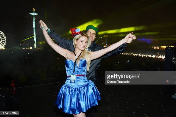 Holly Madison and Pasquale Rotella attend the Electric Daisy Carnival London 2013 at Queen Elizabeth Olympic Park on July 20 2013 in London England