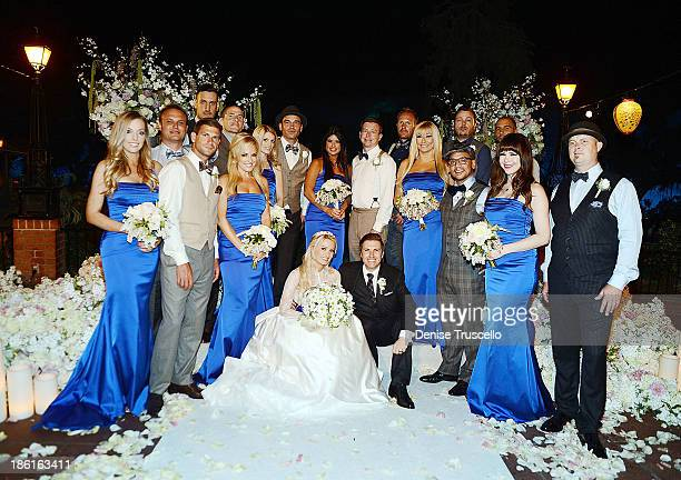 Holly Madison and Pasquale Rotella pose for photos with their wedding party at Disneyland on September 10 2013 in Anaheim California