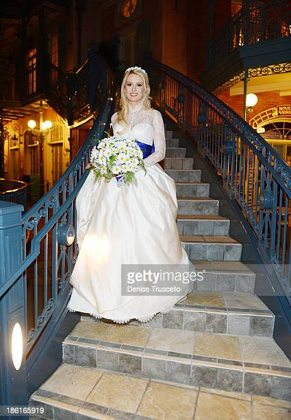 Holly Madison poses for photos before her wedding at Disneyland on September 10 2013 in Anaheim California