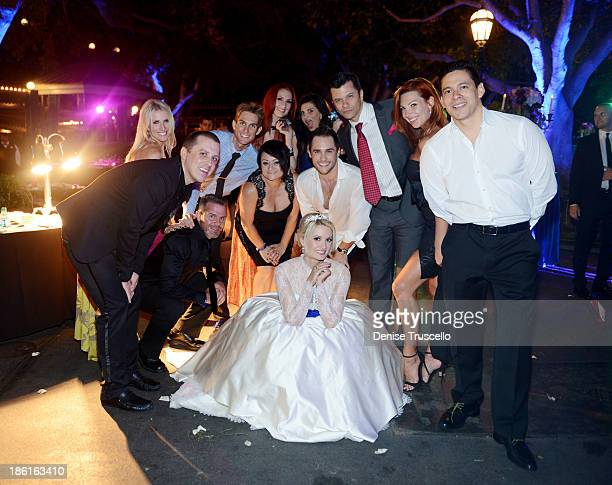 Holly Madison poses for photos with friends Mike Snedeger James Garrett Josh Strickland Todd DuBail Tara Palsha and Alex Acuna during her wedding...