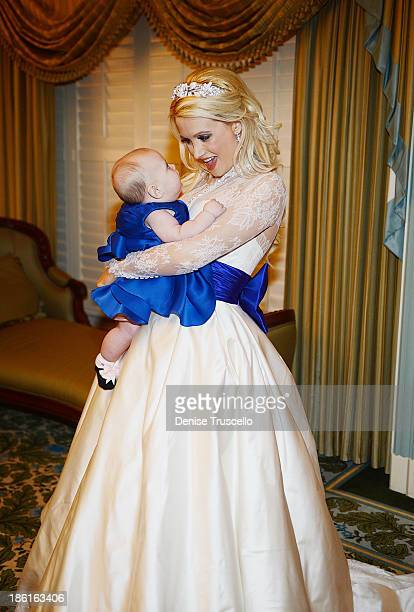 Holly Madison poses for photos with her daughter Rainbow Rotella before her wedding at Disneyland on September 10 2013 in Anaheim California