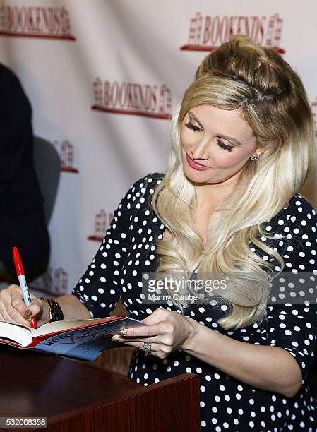 Holly Madison signs copies of her new book 'The Vegas Diaries' at Bookends Bookstore on May 17, 2016 in Ridgewood, New Jersey.