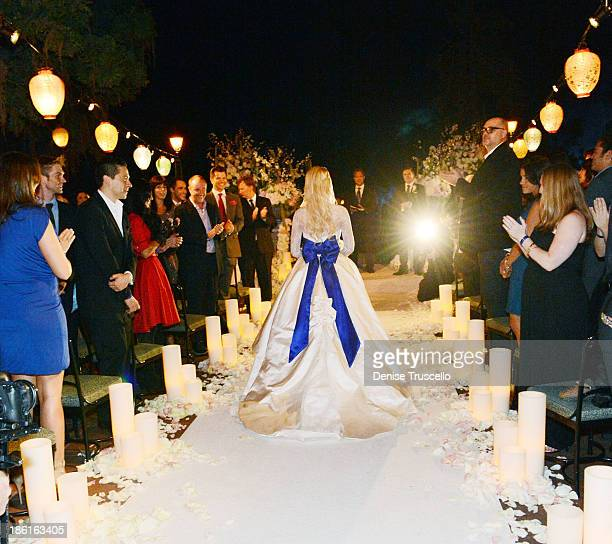 Holly Madison walks down the isle during her wedding at Disneyland on September 10 2013 in Anaheim California
