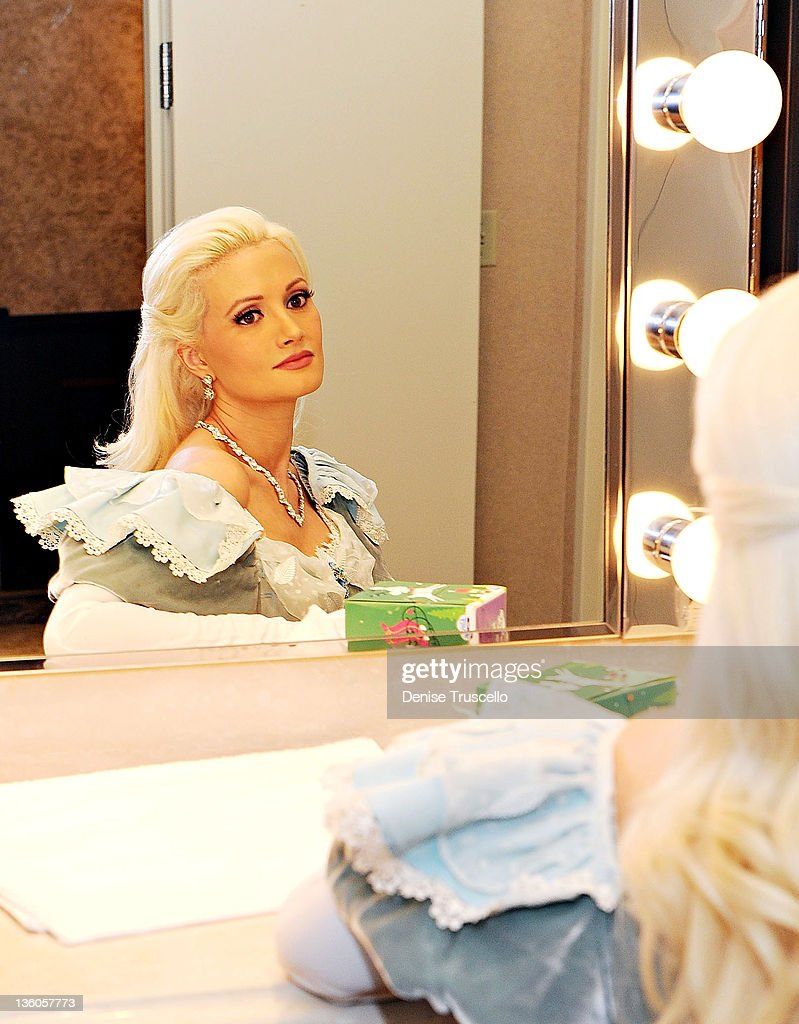 Holly Madison's image is reflected in a mirror as she looks on backstage before her appearance in Nevada Ballet Theatre's The Nutcracker performance at Paris Las Vegas on December 17, 2011 in Las Vegas, Nevada.