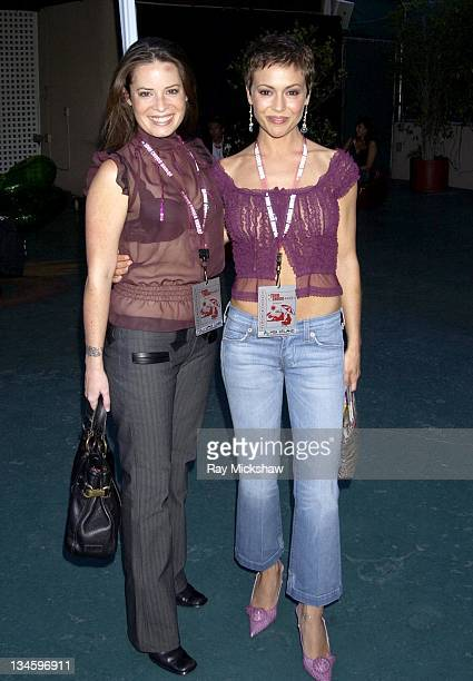 Holly Marie Combs and Alyssa Milano during 2003 Teen Choice Awards Blue Carpet at Universal Amphitheatre in Universal City California United States