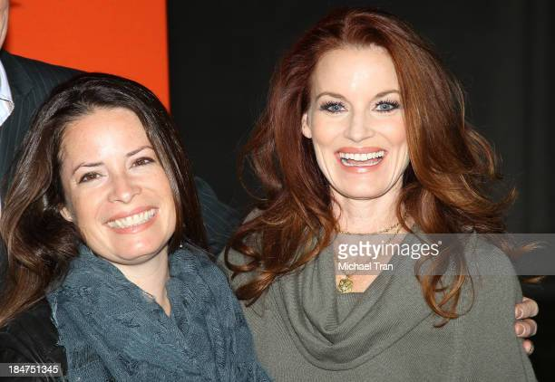 Holly Marie Combs and Laura Leighton arrive at the 'Pretty Little Liars' celebrates Halloween episode held at Hollywood Forever on October 15 2013 in...