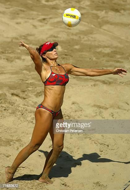 Holly McPeak serves the ball against Carrie Dodd and Barbra Fontana during the AVP Manhattan Beach Open match on August 11, 2006 in Manhattan Beach,...