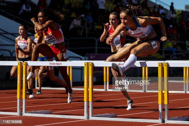 Holly Mills of Great Britain Annik Kaelin of Switzerland and Maria Vicente of Spain compete during Heptathlon 100m Hurdles Women on July 18 2019 in...