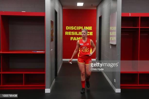 Holly Mirfield of the Suns walks out of the rooms for the AFLW Winter Series match between the Gold Coast Suns and the Brisbane Lions at Metricon...