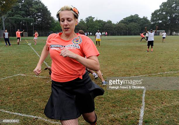 Holly Owens of team Snatching Fire crosses home plate during a Stonewall Kickball game in Raleigh NC on Oct 12 2014 Stonewall Kickball is an...