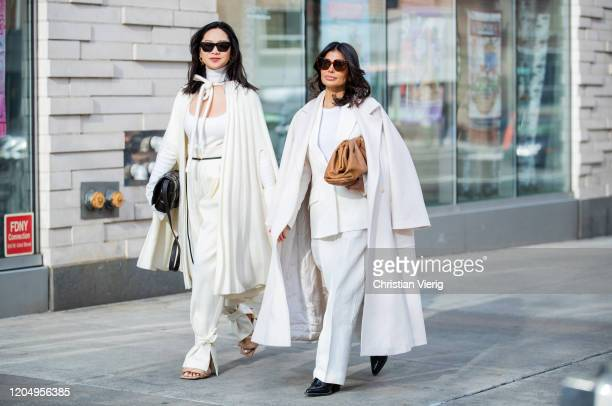 Holly Pan wearing white coat top pants black bag sandals Bottega and Victoria Barbara is seen wearing white Jil Sander suit Max Mara white coat brown...