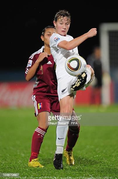 Holly Patterson of New Zealand is challenged by Soleidys Rengel of Venezuela during the FIFA U17 Women's World Cup Group C match between New Zealand...