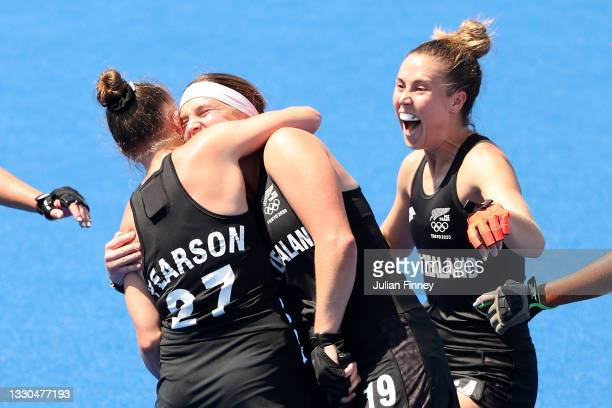Holly Pearson of Team New Zealand is congratulated by Tessa Jopp and teammates after scoring Team New Zealand's third goal during the Women's Pool B...