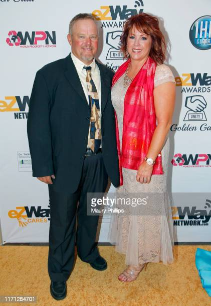 Holly Porter and guest attend the eZWay Awards Golden Gala at Center Club Orange County on August 30 2019 in Costa Mesa California