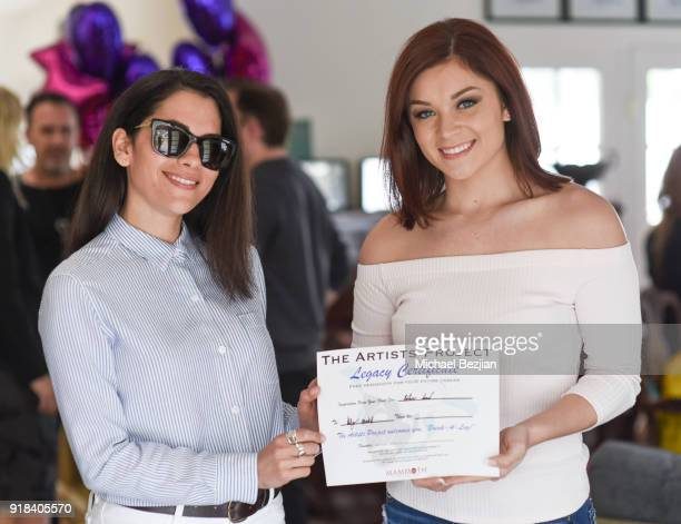 Holly Powell receiving certificate from Inbar Lavi at The Artists Project Giveback Day on February 14 2018 in Los Angeles California