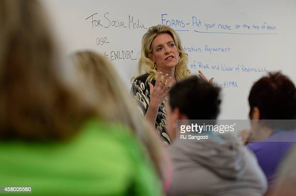 Holly R Wyatt MD teaches a class as part of the sixday weight loss camp at Anschutz Health and Wellness Center October 27 2014 Weight loss camp at...