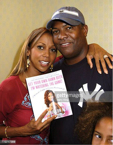 """Holly Robinson Peete and Rodney Peete during Holly Robinson Peete Signs Her Book """"Get Your Own Damn Beer, I'm Watching the Game!"""" at Barnes & Noble..."""