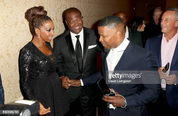 Holly Robinson Peete Rodney Peete and Jamie Foxx at the 17th Annual Harold Carole Pump Foundation Gala at The Beverly Hilton Hotel on August 11 2017...