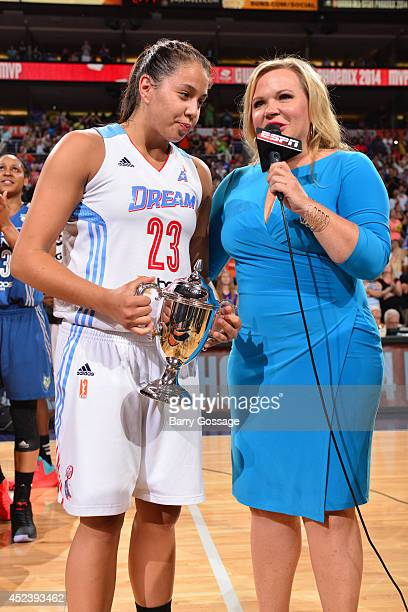 Holly Rowe of ESPN interviews Shoni Schimmel of the Eastern Conference AllStars after she won the MVP trophy following the 2014 Boost Mobile WNBA...