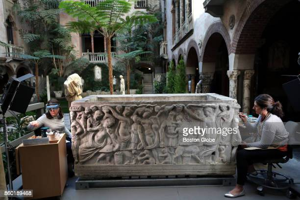 Holly Salmon left senior objects conservator and Jess Chloros associate objects conservator work on the Farnese Sarcophagus thought to have been...