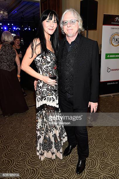 Holly Selph and musician Mike Mills attend Unbridled Eve Gala during the 142nd Kentucky Derby on May 6 2016 in Louisville Kentucky