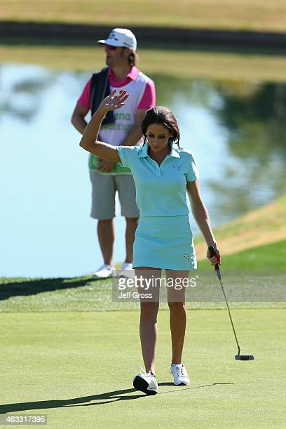 Holly Sonders acknowledges the gallery on the eighth hole of the Jack Nicklaus Private Course at PGA West during the second round of the Humana...