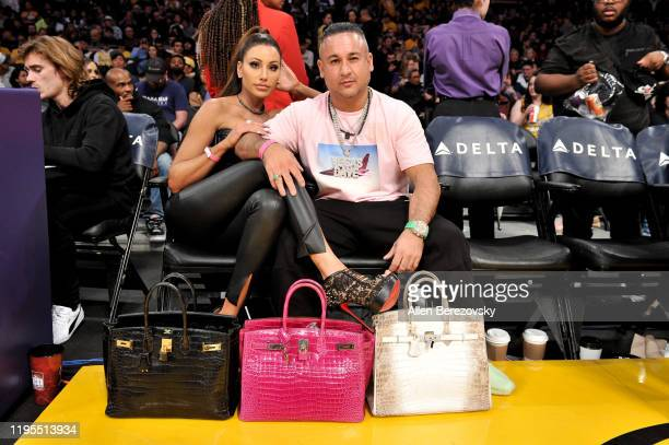 Holly Sonders and Vegas Dave attend a basketball game between the Los Angeles Lakers and the Denver Nuggets at Staples Center on December 22 2019 in...