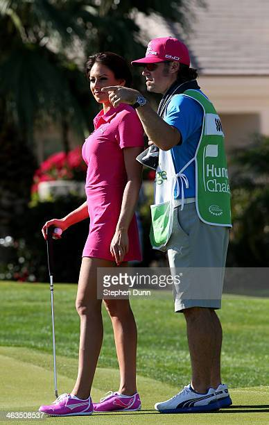 Holly Sonders consutls with her caddie on the green on the second hole during the third round of the Humana Challenge in partnership with the Clinton...