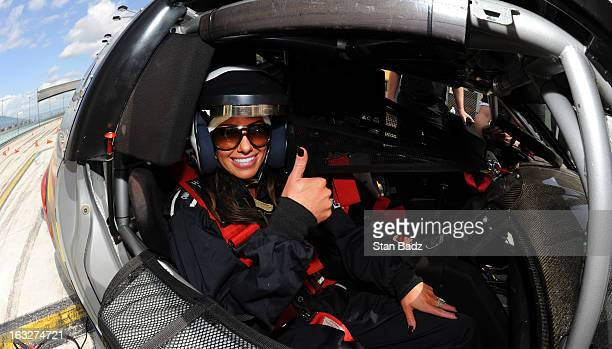 Holly Sonders host of Morning Drive on the Golf Channel poses for a photo before taking a ride in a Cadillac CTSV race car around the HomesteadMiami...