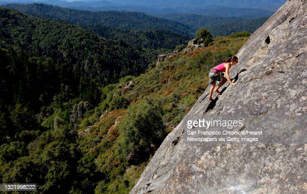 Holly Tate, of Santa Cruz climbs Goat Rock, a popular climbing spot at Castle Rock State Park on Wednesday August 17 in Los Gatos, Ca. Castle Rock is...