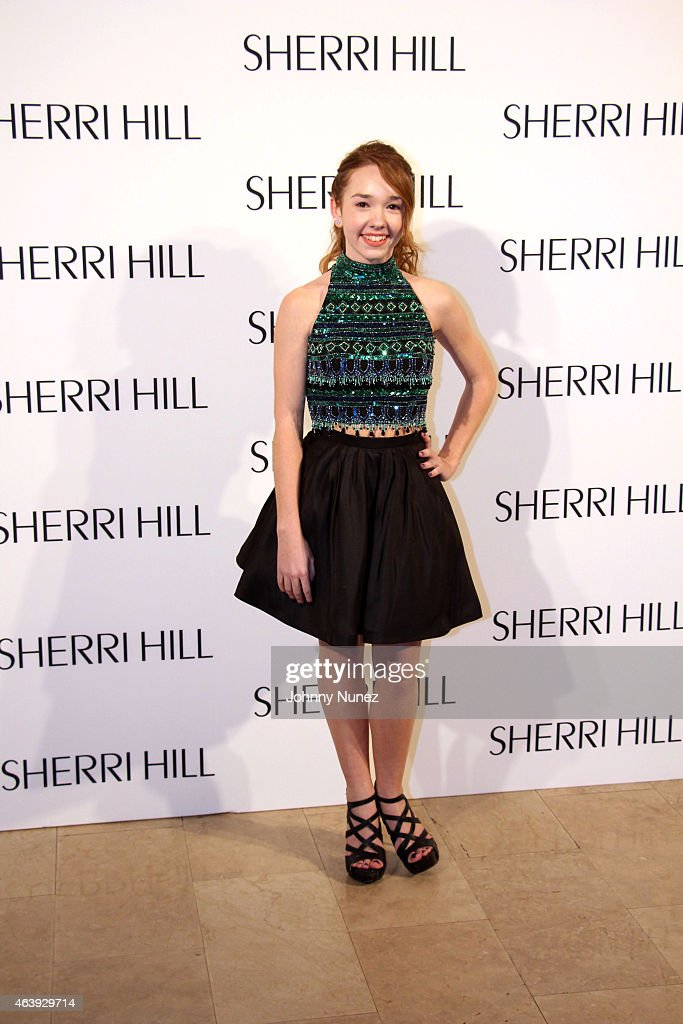 Holly Taylor attends the Sherri Hill fall 2015 fashion show at The
