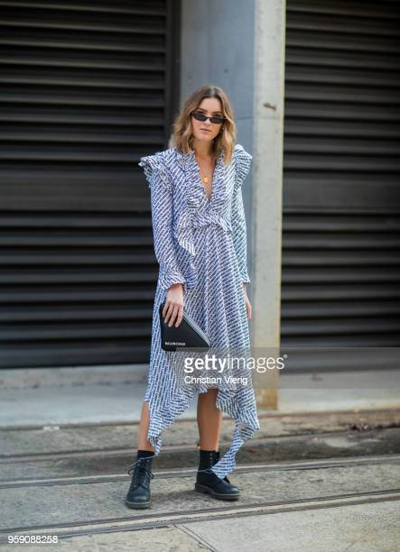 Holly Titheridge wearing Vetements dress Balenciaga triangle bag Dr Martens boots during MercedesBenz Fashion Week Resort 19 Collections at...