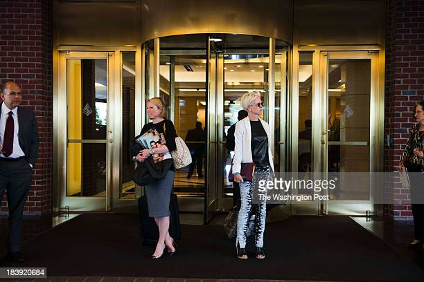 Holly Whidden Director Editorial Brand Strategy at Cosmopolitan magazine left and Joanna Coles editorinchief of Cosmopolitan magazine right wait for...